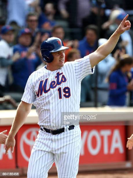 Jay Bruce of the New York Mets salutes teammate Lucas Duda after Duda drove him in with a 3 RBI double in the seventh inning against the Atlanta...
