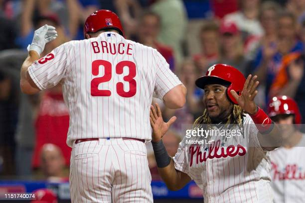 Jay Bruce of the Philadelphia Phillies celebrates with Maikel Franco after hitting a pinchhit two run home run in the bottom of the sixth inning...