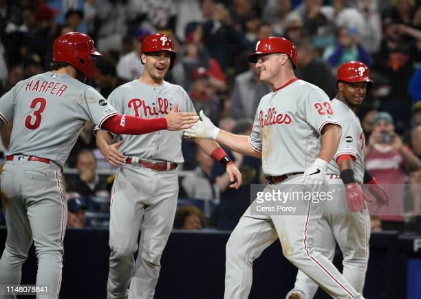 Jay Bruce of the Philadelphia Phillies is congratulated by Bryce Harper, J.T. Realmuto and Jean Segura after hitting a grand slam during the fifth...