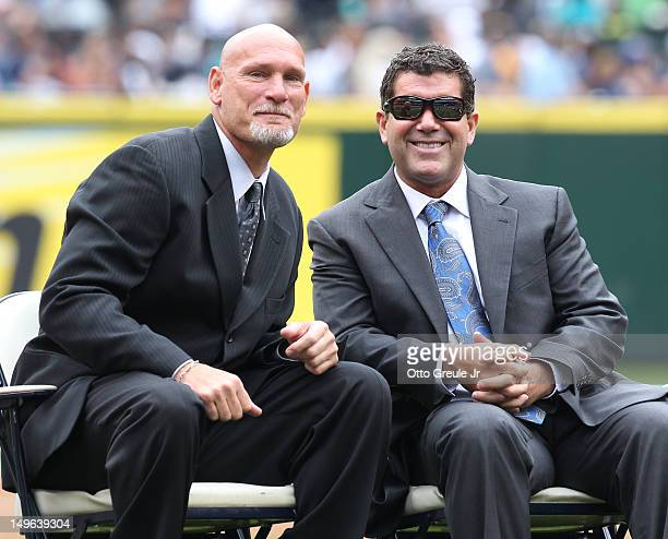 Jay Buhner and Edgar Martinez look on during a ceremony inducting former Mariner greats Dan Wilson and Randy Johnson into the Seattle Mariners' Hall...