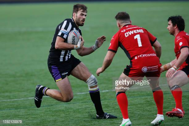 Jay Chapelhow of Newcastle Thunder drives in to Jack Owens of Widnes Vikings during the BETFRED Championship match between Newcastle Thunder and...