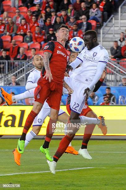 BMO FIELD TORONTO ONTARIO CANADA Jay Chapman and Lamine Sané seen jumping for the ball during 2018 MLS Regular Season match between Toronto FC and...