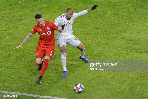 BMO FIELD TORONTO ONTARIO CANADA Jay Chapman and Teal Bunbury fight for the ball during 2019 MLS Regular Season match between Toronto FC and New...