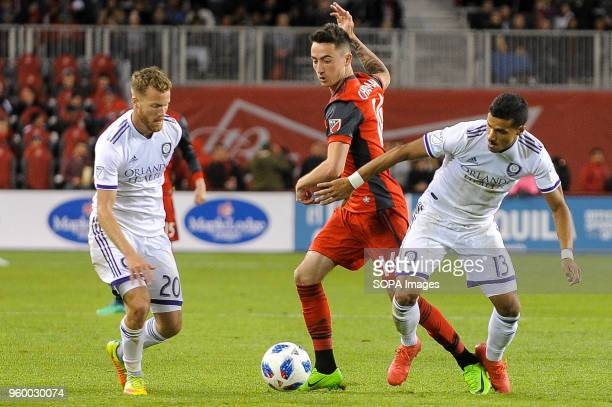 BMO FIELD TORONTO ONTARIO CANADA Jay Chapman between two rivals during 2018 MLS Regular Season match between Toronto FC and Orlando City SC at BMO...
