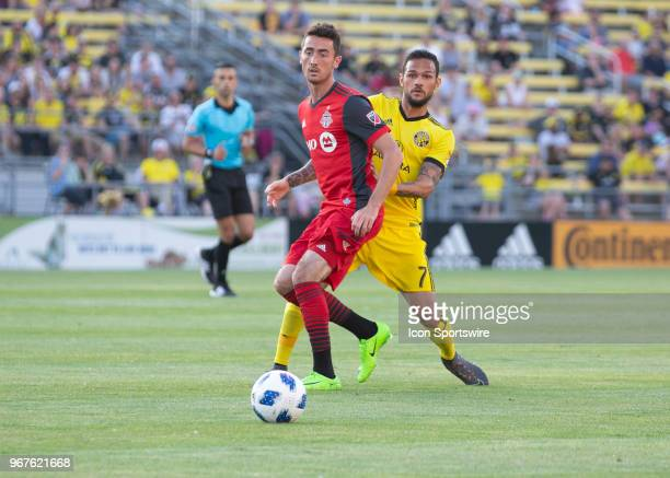 Jay Chapman of Toronto FC and Artur of Columbus Crew SC looks on during the game between the Columbus Crew SC and the Toronto FC at MAPFRE Stadium in...