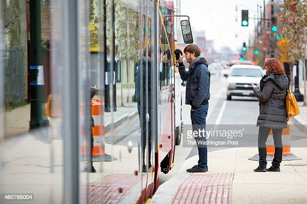 Jay Chmilewski a transportation engineer from Washington DC and Veronika Zhiteneva of Maryland check out a new streetcar that was rolled onto the...
