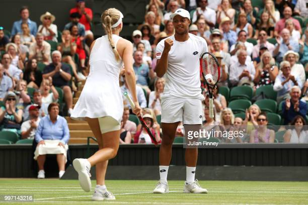 Jay Clarke and Harriet Dart of Great Britain celebrate a point against Juan Sebastian Cabal of Colombia and Abigail Spears of the United States...