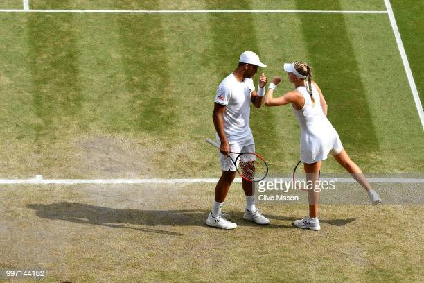 Jay Clarke and Harriet Dart of Great Britain discuss tactics during their Mixed Doubles quarterfinal against Juan Sebastian Cabal of Colombia and...