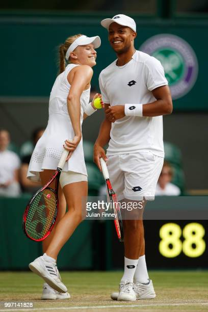 Jay Clarke and Harriet Dart of Great Britain laugh as they discuss tactics during their Mixed Doubles quarterfinal against Juan Sebastian Cabal of...