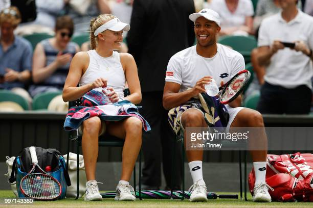 Jay Clarke and Harriet Dart of Great Britain laugh laugh during a break in their Mixed Doubles quarterfinal match against Juan Sebastian Cabal of...