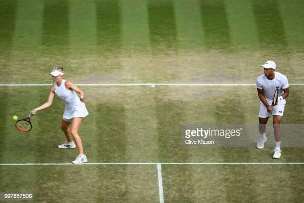 Jay Clarke and Harriet Dart of Great Britain return against Jamie Murray of Great Britain and Victoria Azarenka of Belarus during their Mixed Doubles...