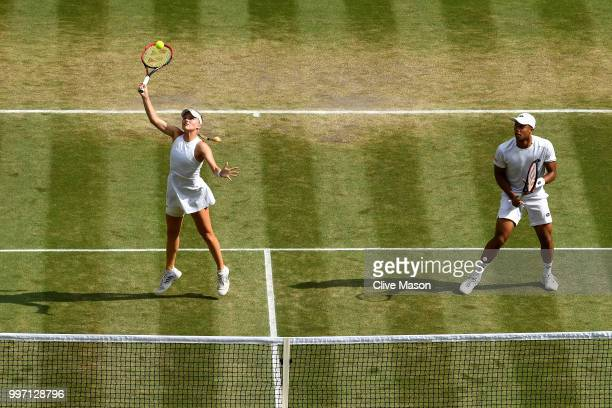 Jay Clarke and Harriet Dart of Great Britain return against Juan Sebastian Cabal of Colombia and Abigail Spears of the United States during their...