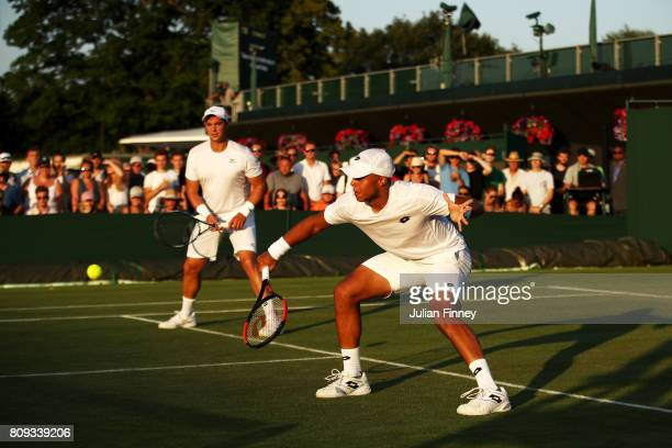 Jay Clarke of Great Britain and Marcus Willis of Great Britain in action during the Gentlemen's Doubles first round match against Jared Donaldson of...