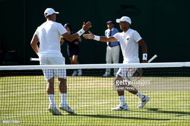 Jay Clarke of Great Britain and Marcus Willis of Great Britain celebrate together during the Gentlemen's Doubles first round match against Jared...