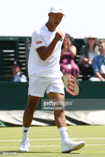 Jay Clarke of Great Britain celebrates a point against Ernests Gulbis of Latvia during their Men's Singles first round match on day two of the...