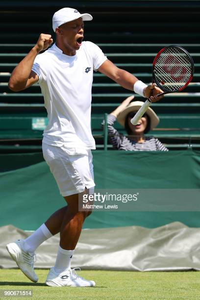 Jay Clarke of Great Britain celebrates winning the fourth set during his Men's Singles first round match against Ernests Gulbis of Latvia on day two...