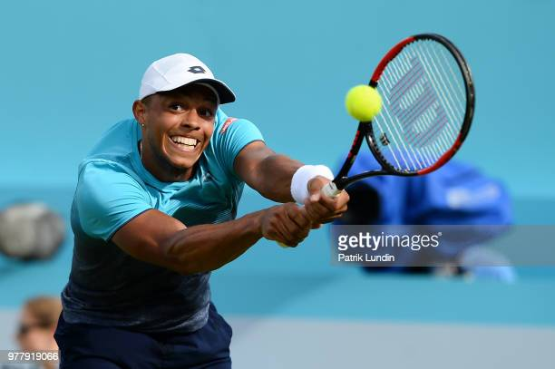 Jay Clarke of Great Britain hits a backhand during the first round match against Sam Querrey of the United States during Day one of the FeverTree...