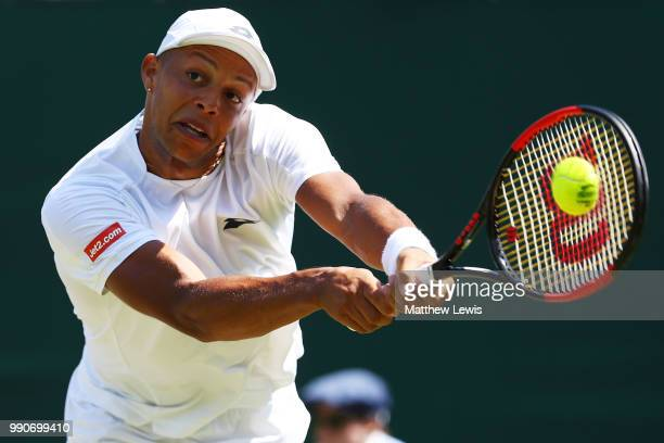 Jay Clarke of Great Britain plays a backhand against Ernests Gulbis of Latvia during their Men's Singles first round match on day two of the...