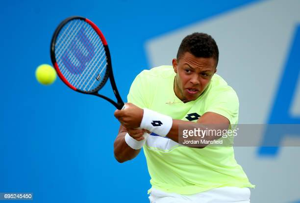 Jay Clarke of Great Britain plays a backhand during his Men's first round match against Yuki Bhambri of India during day one of the Aegon Open at...