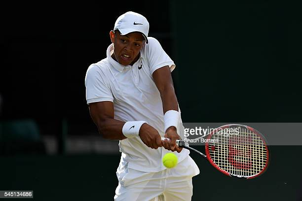 Jay Clarke of Great Britain plays a backhand during the Boy's Doubles first round match against Alejandro Davidovich Fokina of Spain and Alexei...