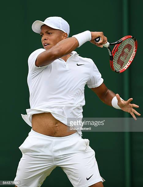 Jay Clarke of Great Britain plays a backhand during the Boy's singles first round match against Tomas Martin Etcheverry of Argentina on Middle Sunday...
