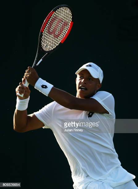 Jay Clarke of Great Britain plays a backhand with Marcus Willis of Great Britain during the Gentlemen's Doubles first round match against Jared...