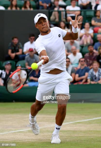 Jay Clarke of Great Britain plays a forehand during the Gentlemen's Doubles second round match with Marcus Willis of Great Britain against...