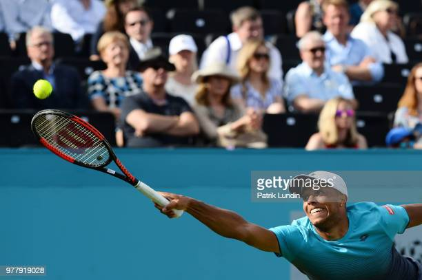 Jay Clarke of Great Britain reach for a hits a forehand during the first round match against Sam Querrey of the United States during Day one of the...