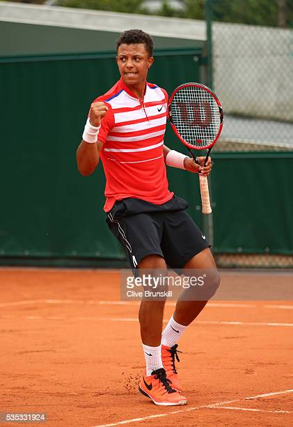 Jay Clarke of Great Britain reacts during the Boys Singles first round match against Yibing Wu of China on day eight of the 2016 French Open at...