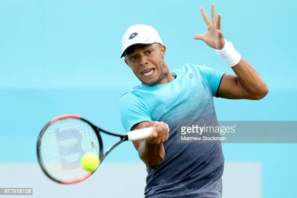 Jay Clarke of Great Britain returns a shot during his men's singles match against Sam Querrey of the United States during Day One of the FeverTree...