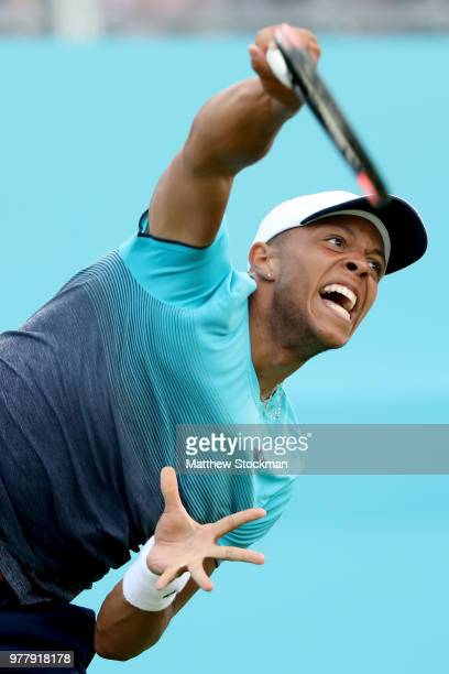 Jay Clarke of Great Britain serves during his men's singles match against Sam Querrey of the United States during Day One of the FeverTree...