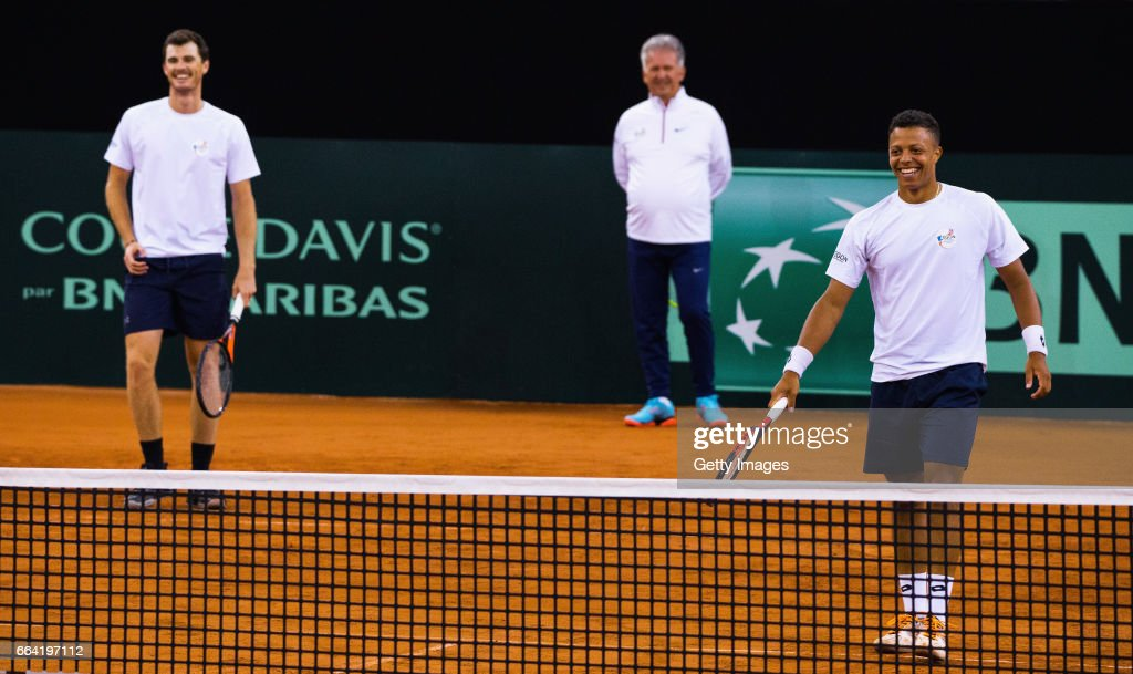 Jay Clarke (R) of Great Britain smiles with Jamie Murray during practice prior to the France v Great Britain Davis Cup World Group Quarter-Final on April 3, 2017 in Rouen, France.