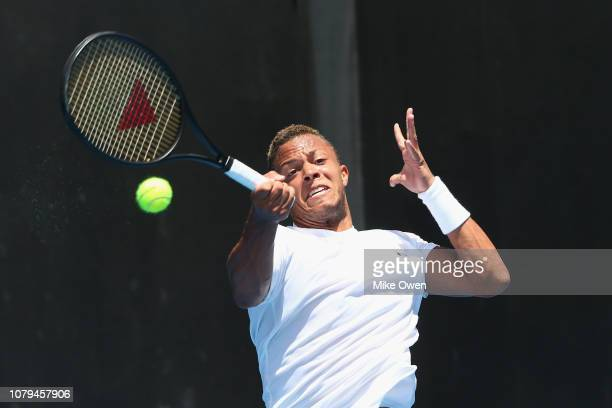 Jay Clarke of the United Kingdom plays a forehand in his match against Lorenzo Sonego of Italy during day two of Qualifying for the 2019 Australian...