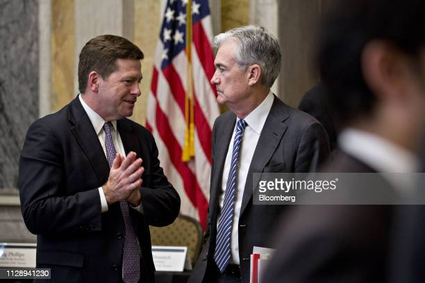 Jay Clayton chairman of the Securities and Exchange Commission left speaks with Jerome Powell chairman of the US Federal Reserve during a Financial...
