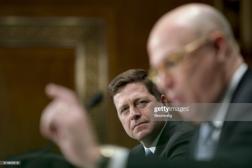 Jay Clayton, chairman of the U.S. Securities and Exchange Commission (SEC), center, listens during a Senate Banking, Housing and Urban Development Committee hearing in Washington, D.C., U.S., on Tuesday, Feb. 6, 2018. Cryptocurrency exchanges roiled by the rout in Bitcoin prices may face more turbulence as the two top U.S. market regulators ask Congress to consider federal oversight for the trading platforms. Photographer: Andrew Harrer/Bloomberg via Getty Images