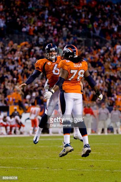 Jay Cutler and Ryan Clady both of the Denver Broncos celebrate a touchdown against the Kansas City Chiefs at Invesco Field at Mile High on December...