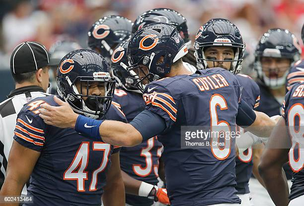 Jay Cutler celebrates Paul Lasike of the Chicago Bears touchdown against the Houston Texans in the first quarter at NRG Stadium on September 11 2016...