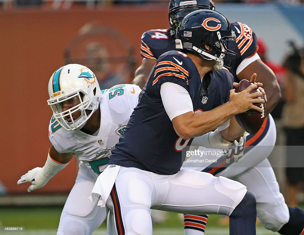 Jay Cutler #6 of the Chicago Bears gets away from Olivier Vernon #50 of the Miami Dolphins during a preseason game at Soldier Field on August 13, 2015 in Chicago, Illinois.