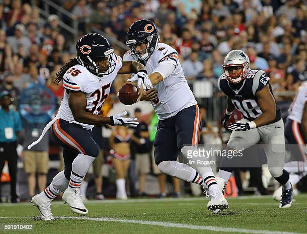 Jay Cutler of the Chicago Bears hands the ball to Jacquizz Rodgers in the first half at Gillette Stadium on August 18 2016 in Foxboro Massachusetts