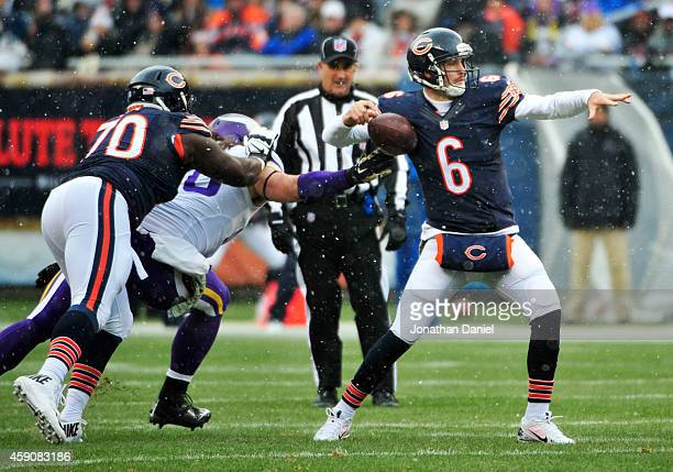 Jay Cutler of the Chicago Bears has the ball knocked loose by Brian Robison of the Minnesota Vikings during the second quarter of a game against the...