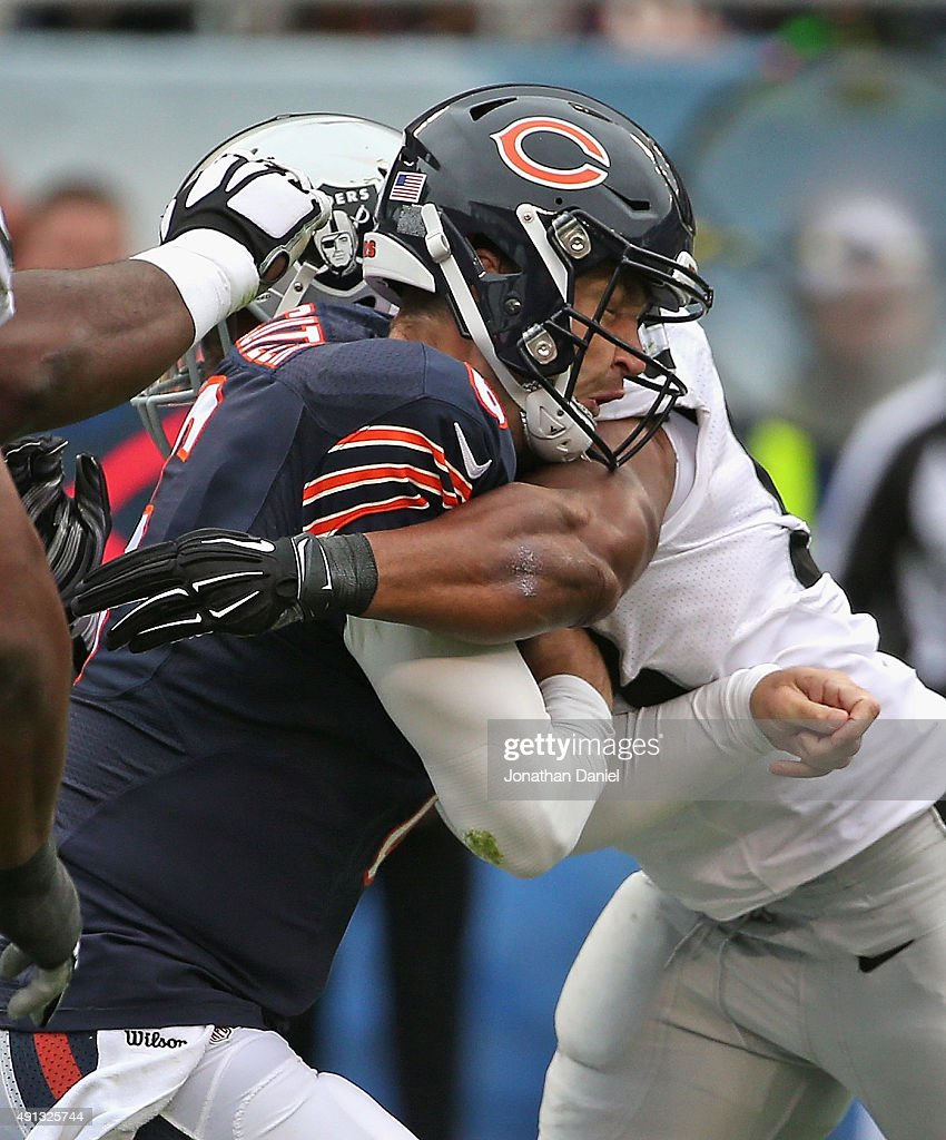 Jay Cutler #6 of the Chicago Bears is hit after throwing by Malcolm Smith #53 of the Oakland Raiders at Soldier Field on October 4, 2015 in Chicago, Illinois. The Bears defeated the Raiders 22-20.