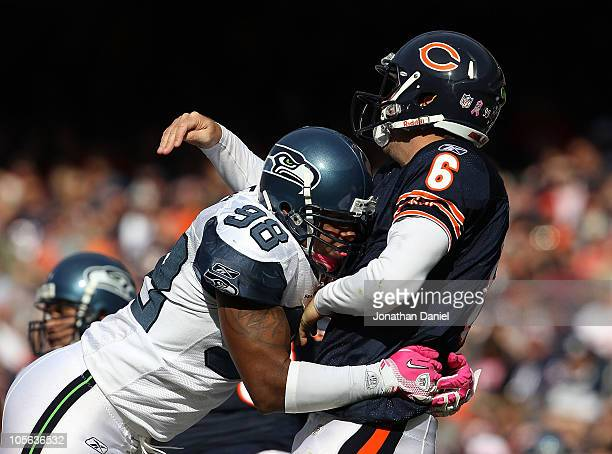 Jay Cutler of the Chicago Bears is hit after throwing by Raheem Brock of the Seattle Seahawks at Soldier Field on October 17 2010 in Chicago Illinois...