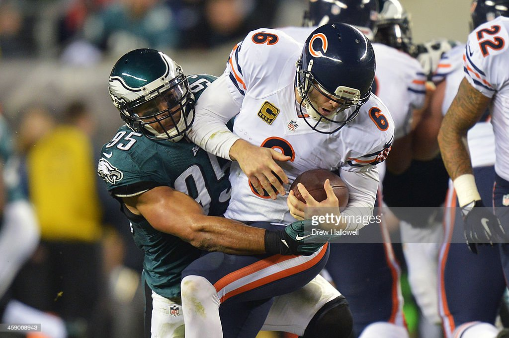 Jay Cutler #6 of the Chicago Bears is sacked by Mychal Kendricks #95 of the Philadelphia Eagles at Lincoln Financial Field on December 22, 2013 in Philadelphia, Pennsylvania. The Eagles won 54-11.