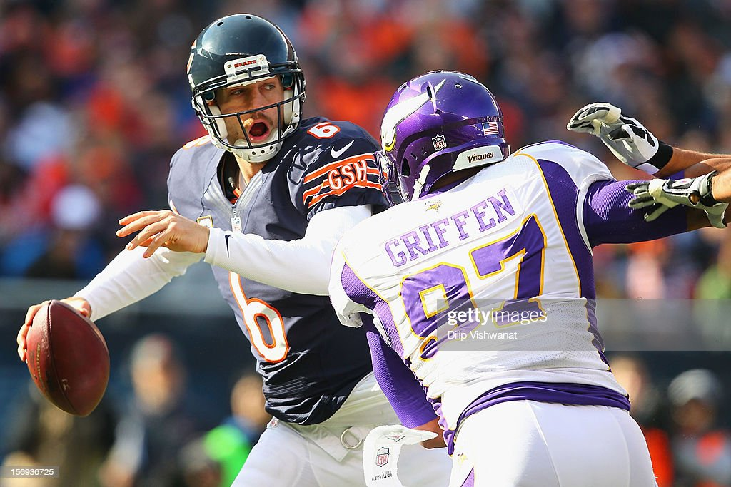 Jay Cutler #6 of the Chicago Bears looks to avoid bing sacked by Everson Griffen #97 of the Minnesota Vikings at Soldier Field on November 25, 2012 in Chicago, Illinois.