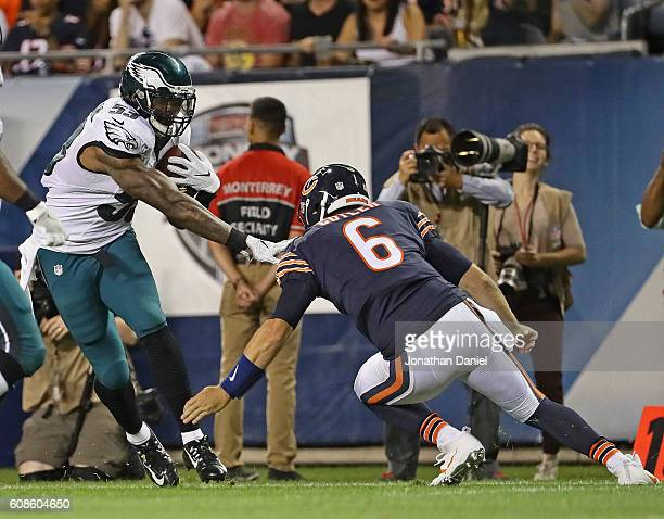 Jay Cutler of the Chicago Bears moves to try and tackle Nigel Bradham of the Philadelphia Eagles after Bradham intecepted his pass at Soldier Field...