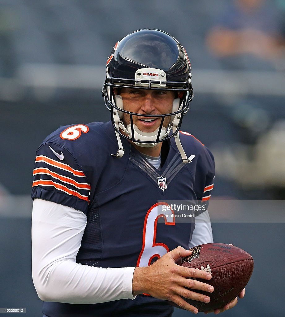 Jay Cutler #6 of the Chicago Bears participates in warmups before their preseason game against the Philadelphia Eagles at Soldier Field on August 8, 2014 in Chicago, Illinois.