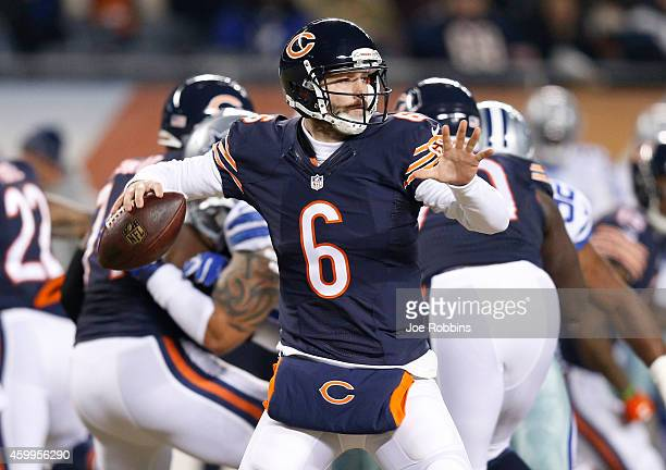 Jay Cutler of the Chicago Bears passes during the first quarter of a game against the Dallas Cowboys at Soldier Field on December 4 2014 in Chicago...