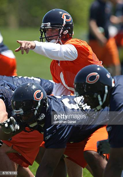 Jay Cutler of the Chicago Bears points to a defensive formation during an organized team activity practice on May 20, 2009 at Halas Hall in Lake...