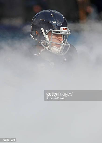 Jay Cutler of the Chicago Bears runs through smoke during player introductions before a game against the Minnesota Vikings at Soldier Field on...