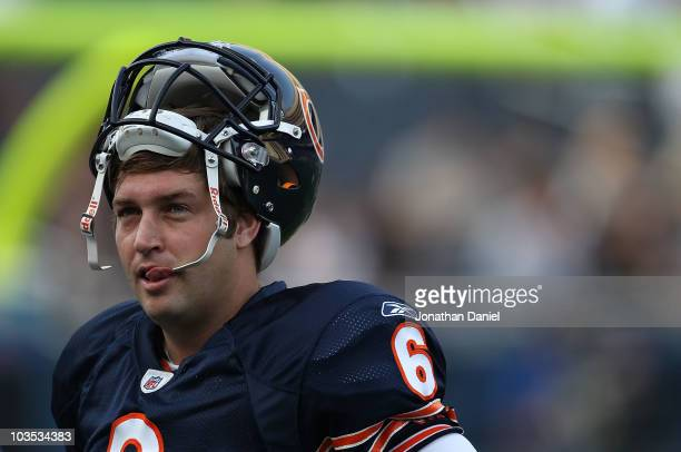 Jay Cutler of the Chicago Bears takes a break during warm-ups before a preseason game against the Oakland Raiders at Soldier Field on August 21, 2010...